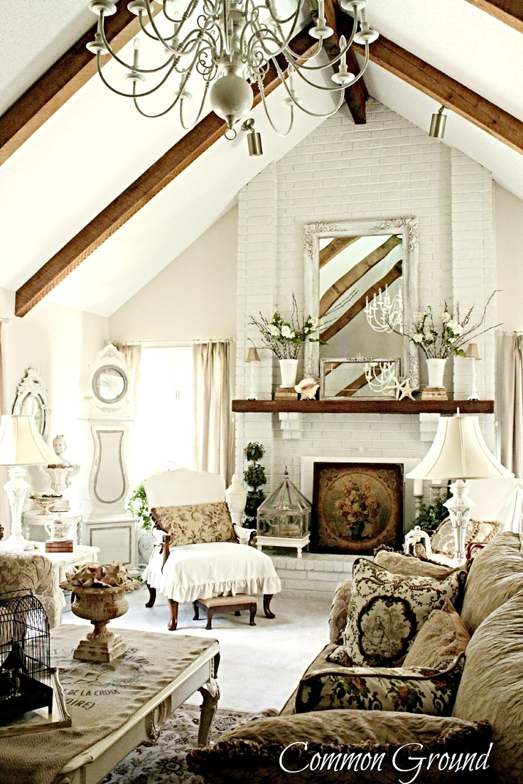 Brick fireplace, wood beams & mantle, vaulted ceiling..not the furnishings, wood floors, natural linen sofas & drapes.