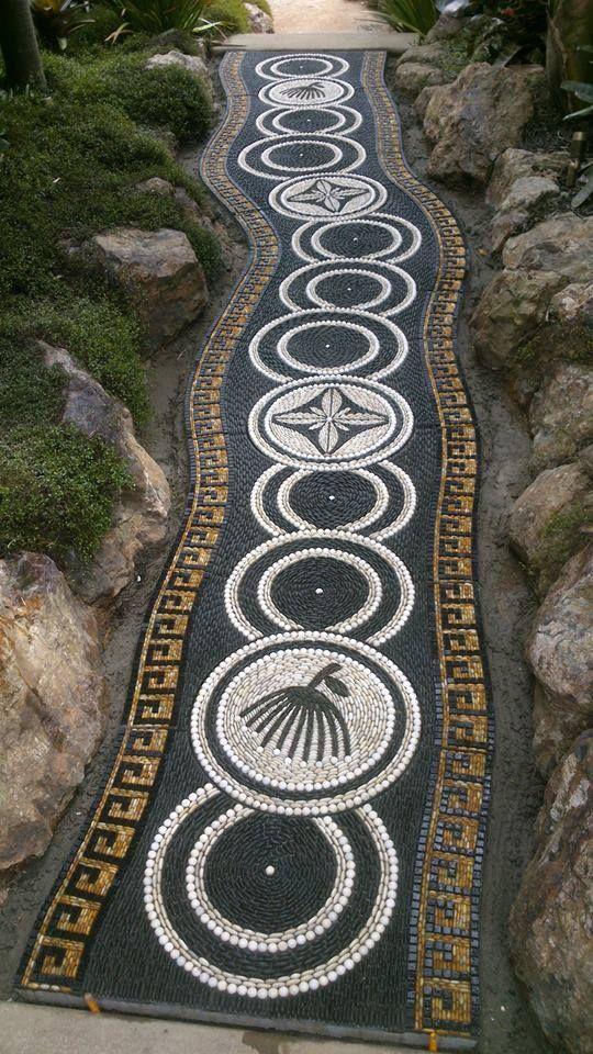 Pebble mosaic path by John Botica http://www.powerofpebbles.com/