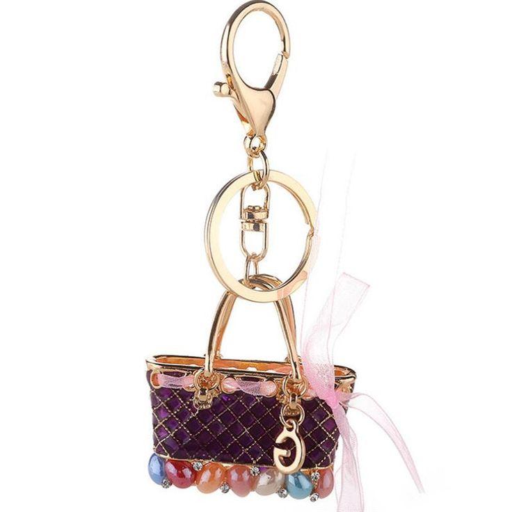 Porte-clés bijoux Style #Créateur #LUXE en forme de sac à main en Alliage de zinc style plaqué or pour femmes.