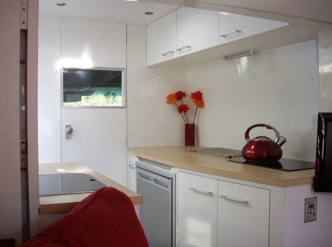 """Talk about a portable tiny house. This is a fantastic """"Stealth Sprinter"""" turned motorhome. From the outside, you'd never know this typical-looking van includes a kitchen, bathroom…"""