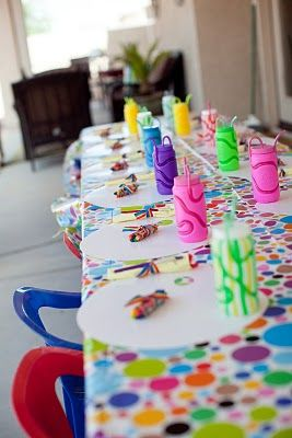 Crazy straw sippy cups and polka dotted table cloth