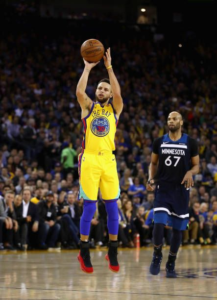 Stephen Curry of the Golden State Warriors shoots against the Minnesota Timberwolves at ORACLE Arena on January 25 2018 in Oakland California NOTE TO...