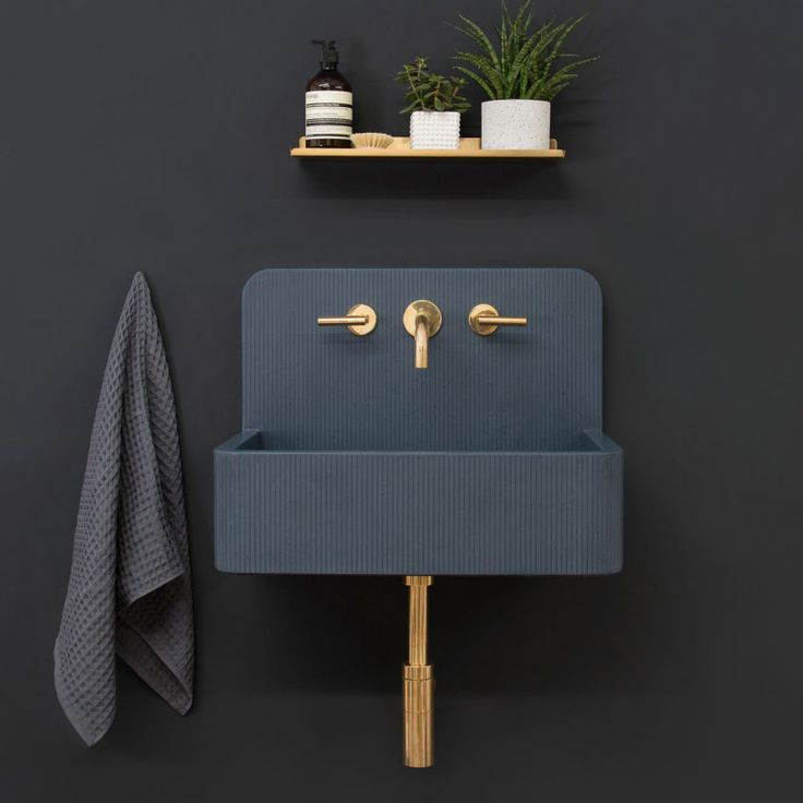 Sink I black wall I copper faucet I black sink I Kast Launches Collection of Patterned Concrete Basins Called Kast Canvas