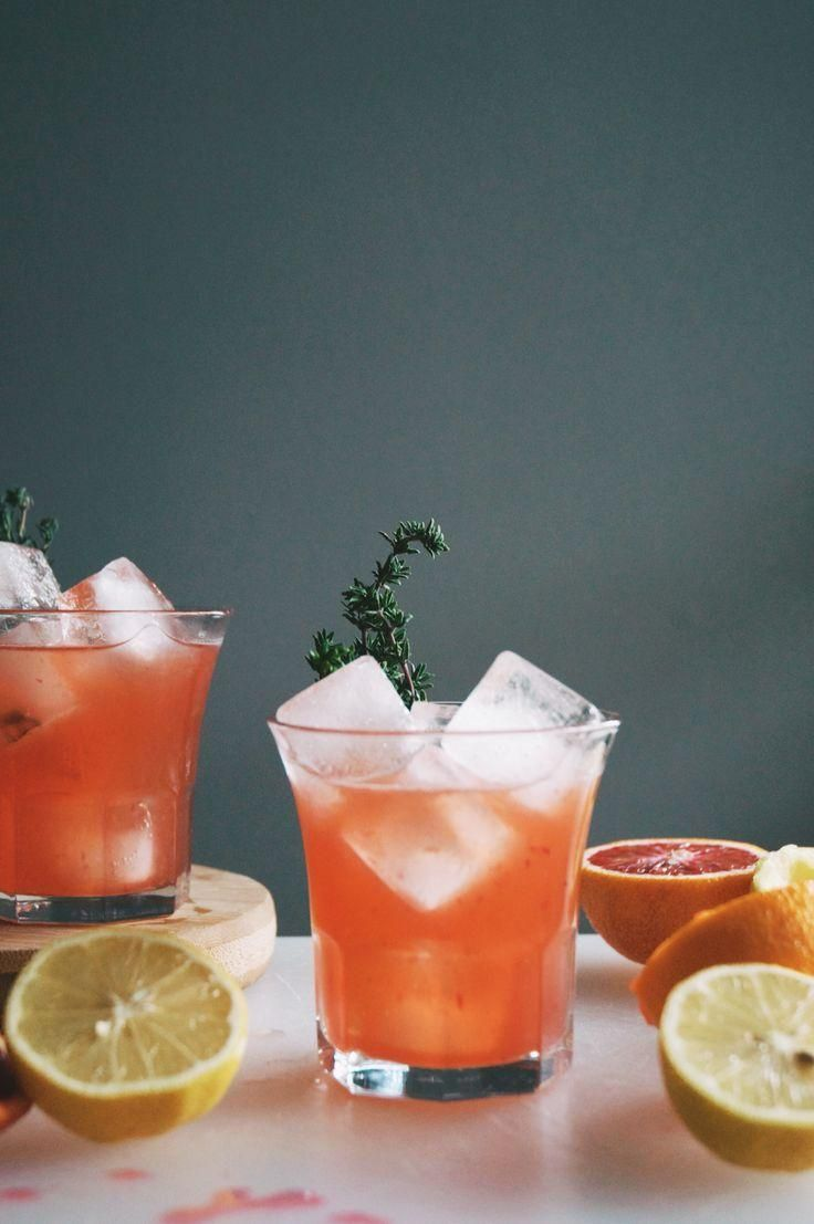 Blood Orange Whiskey Cocktail -- this festive winter cocktail recipe is made with Amaro Nonino Quintessentia (a bitter-sweet Italian deigestif), bourbon, fresh squeezed blood orange juice, lemon juice, bitters, and thyme. Delicious and beautiful!