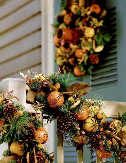 Clove, pinecone, and fresh fruit wreath