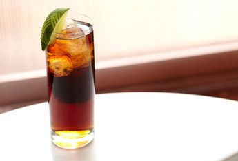 The Henry: 1 oz Captain Morgan, 1/2 oz amaretto, 5 oz cola, 1 lime wedge, 1 cherry. Combine the spiced rum and amaretto in an ice filled shaker. Shake well. Strain into ice filled glass. Fill with cola, garnish with lime and cherry.