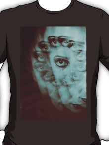 Multiple image of eye of young woman with makeup in dark analog film 35mm photo T-Shirt