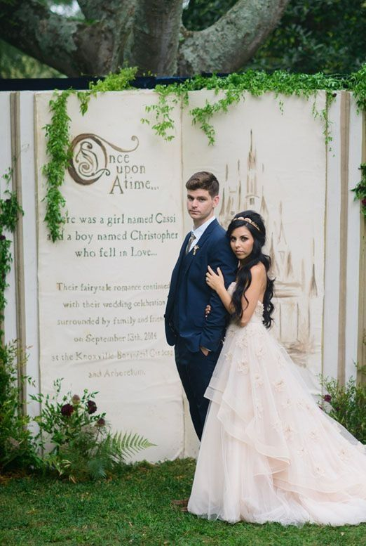 Fairytale wedding Ideas: Garden Wedding Ceremony with large Once Upon a Time book as the backdrop