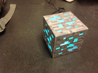 Make your own minecraft lamp - this looks really intricate... maybe I could find a Halloween jack - o - lantern led light changer and just use the box print out and be done with it!  Still a cool idea!!!