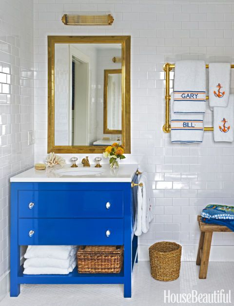 For his Nantucket home's master bath, designer Gary McBournie chose Waterworks hardware in unlacquered brass, so that it would tarnish and age. His goal was to tie all the details back to the nautical feeling of the house. Fore more bathroom decor (that will make you feel like you're at a spa!), click through the gallery.