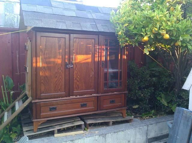 """idea to convert an existing """"box structure""""(An old hutch/entertainment center) to a coop."""