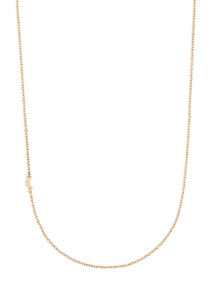 A slim gold chain is affixed with a slim crescent moon on one side, plated in 14K gold.