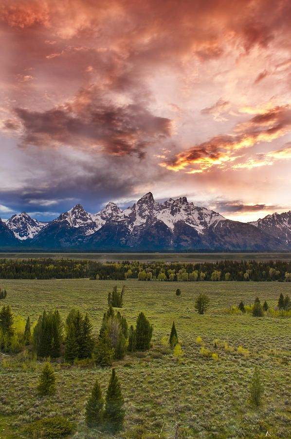 Sunset Over The Tetons is a photograph by Greg Wyatt which was uploaded on May 28th, 2013.