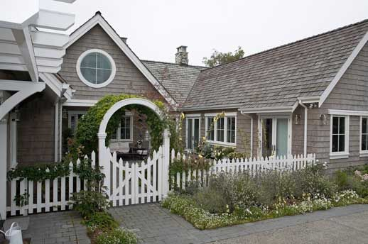 Love how the gate entrance echoes the round window in the roof peak. Daniel A Nelson, AIA