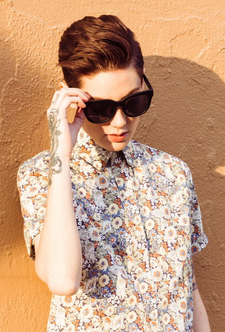 Add a cheeky touch to your spring wardrobe with this vintage inspired, faded floral button up.