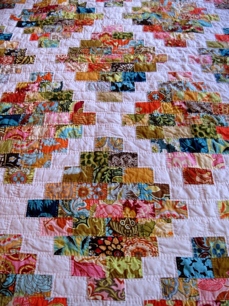 "Scrappy quilt blocks finish at 1.5 x 2.5 (cut 2 x 3); white border is 5"" and quilt finishes at 84 x 70"