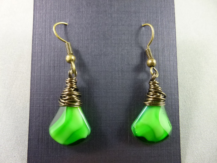 Green lampwork briolettes wrapped with a bronze / copper wire and finished with plated surgical steel earwires.