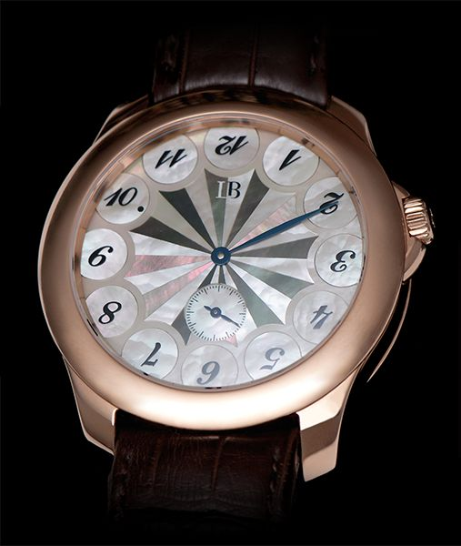 Ludovic Ballouard Upside Down 12 piece Edition 18K RG Manual Wind Available at Cellini Jewelers