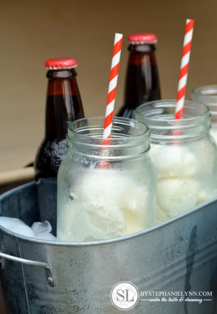Root beer float bar - bottles of root beer and scoops of ice cream in mason jars on ice.