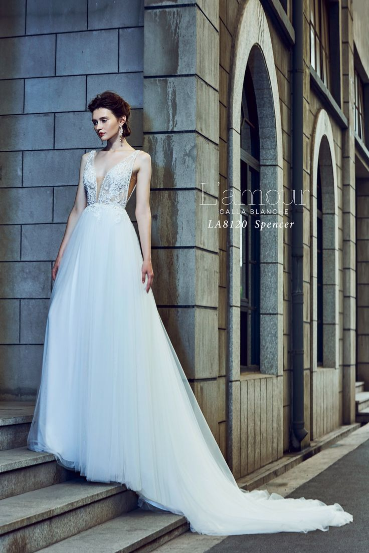 LA8120 Spencer V neck ball gown with beaded appliques and trim.  Made for the modern day princess.  #lamourbycallablanche #lamour #callablanche #callabride #vneck #ballgown #tulleskirt #sheerbodice #modernbride #princess #deepplunge #plunging #neckline