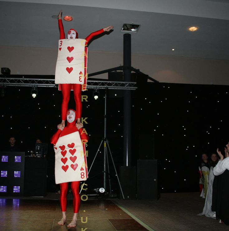 Red Cards perform choreographed acrobalance for guests at this stunning Alice in Wonderland corporate dinner party.  Available to hire across the uk and internationally - London, Manchester, Birmingham, Brighton, Wales.