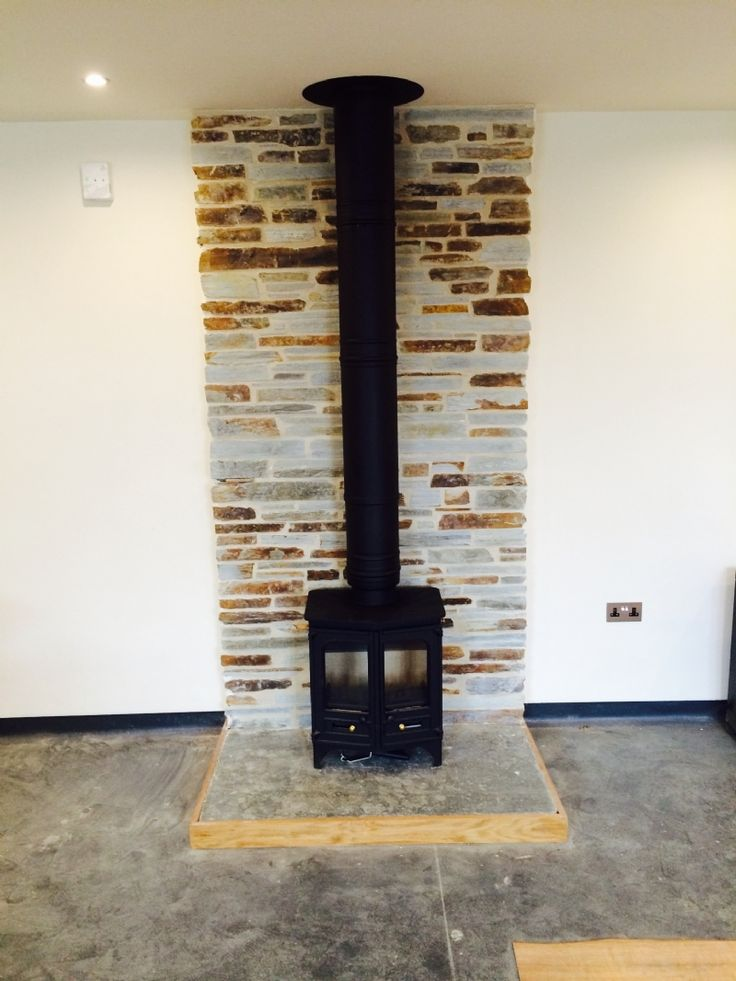 Charnwood Country 6 wood burning stove installation by Kernow Fires in Cornwall.  #charnwood #country6 #woodburner #stove #freestanding #doubledoor #stone #hearth #traditional #twinwall #insulated #kernowfires #wadebridge #redruth #cornwall