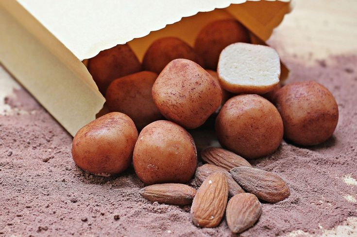 #agriculture #almonds #bag #brown #close up #cooking #dry #food #ground #ingredients #nut #nutrition #paper bag #pile #potatoes #sand