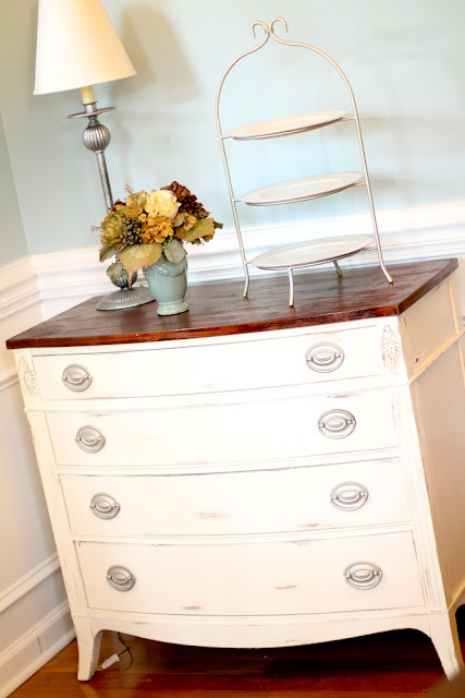 Paint an old dresser an antique white and stain the top a dark rich wood.