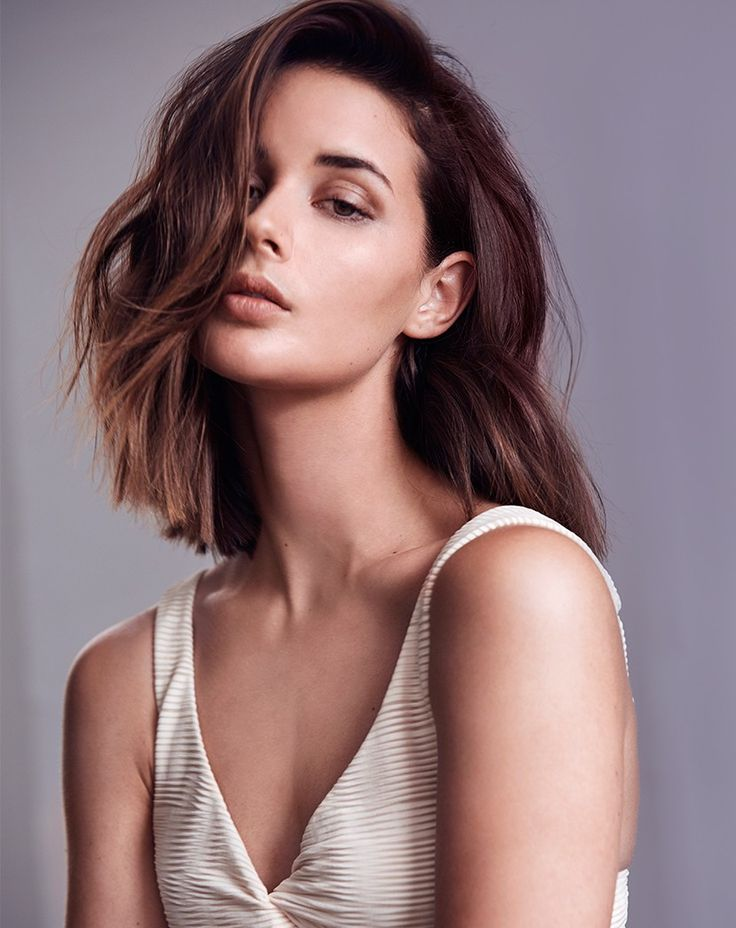A softly layered, almost one-length haircut, with a deep and sweeping side fringe