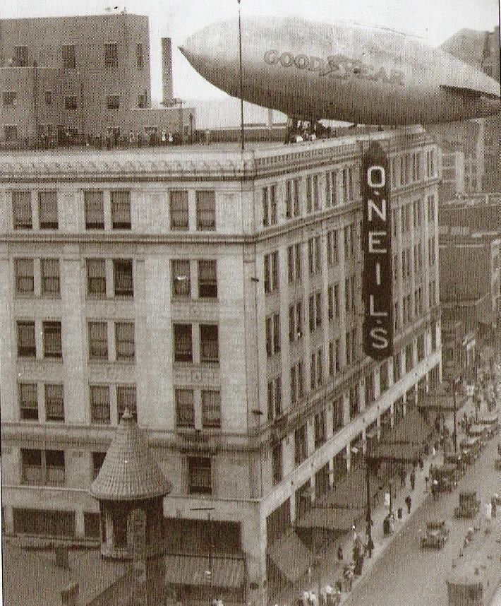 1928. Goodyear Blimp landing on top of the O'Neils building in downtown Akron, Ohio.