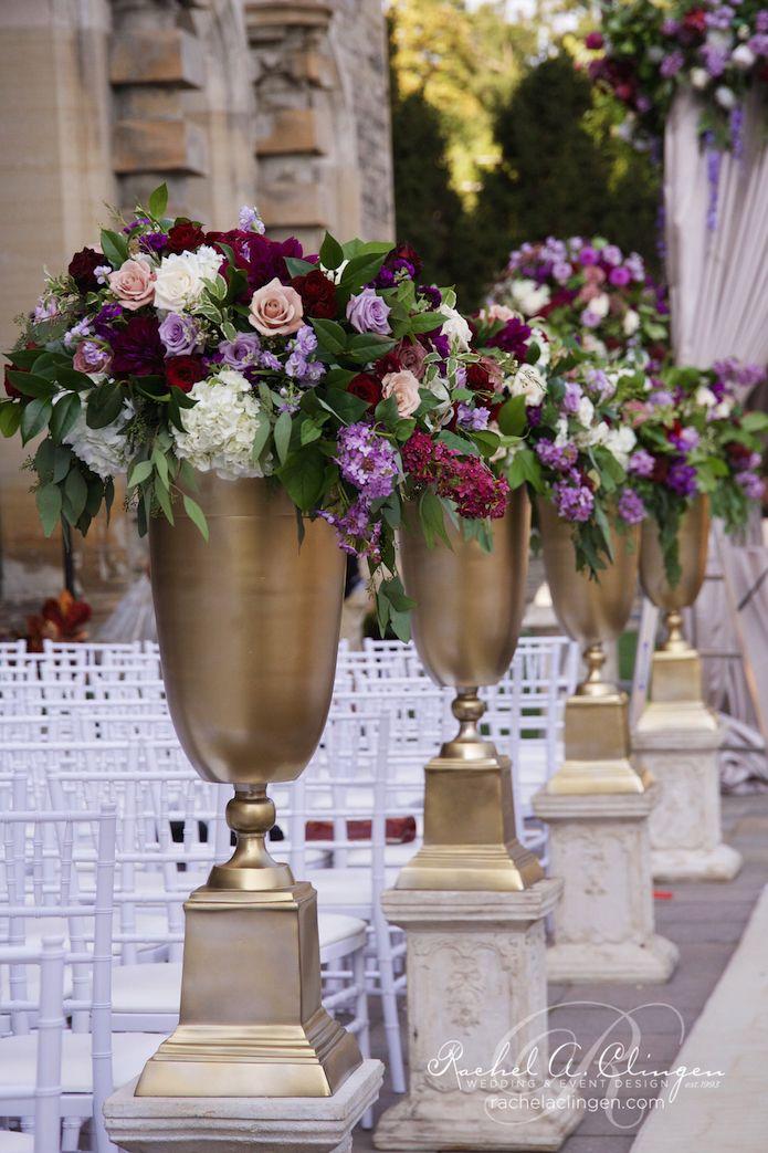 purple mauve and aubergine cream wedding ceremony flowers including dahlias garden roses and