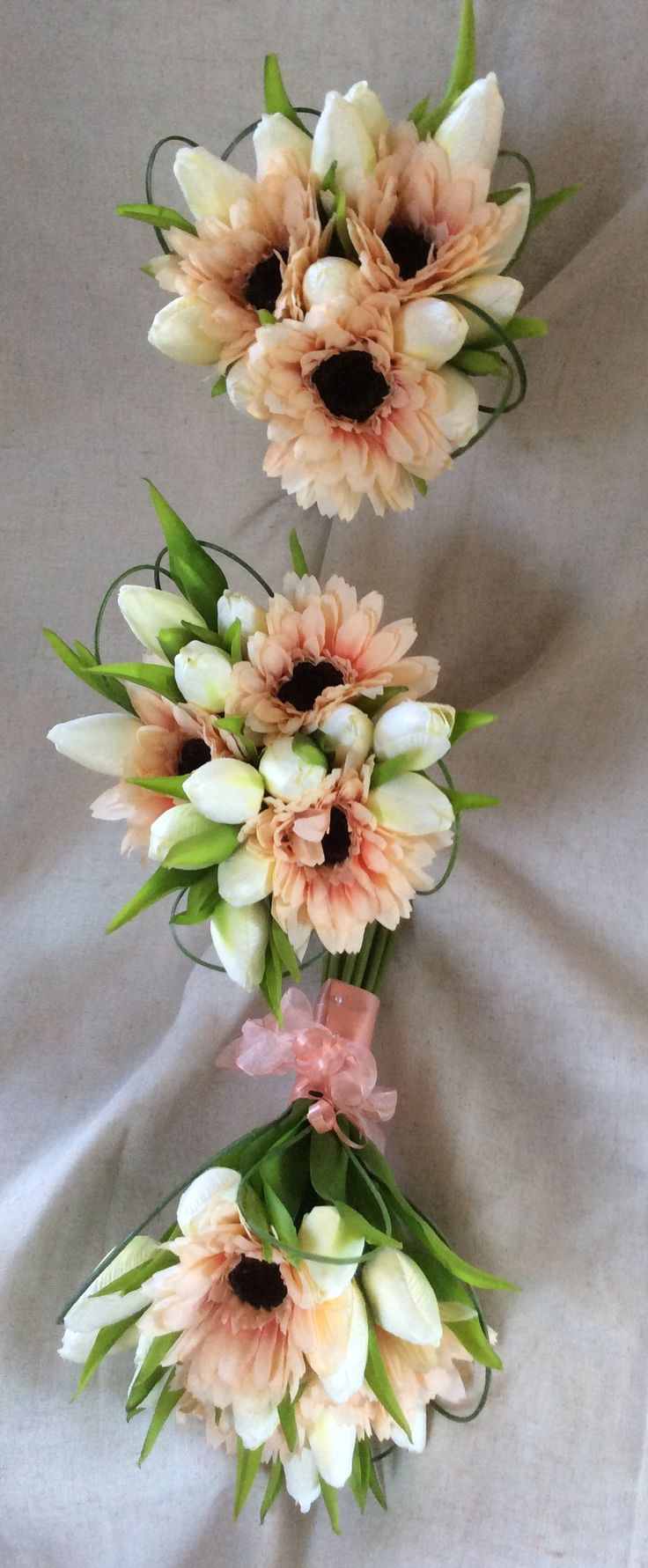 Peach and Ivory gerbera, tulips and roses bouquets by cathey's flowers