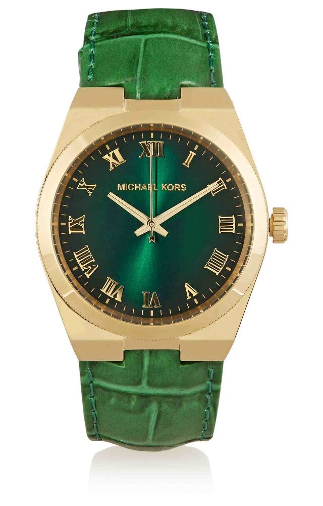 Michael Kors reworks the classic 'Channing' watch in a bold hue and luxurious texture this season. The masculine-inspired green leather band is embossed with a croc effect, while the gold-tone stainless steel bezel enhances the vibrant green face. Designed with classic Roman numerals and water-resistant up to 50 meters, it looks best stacked with bracelets