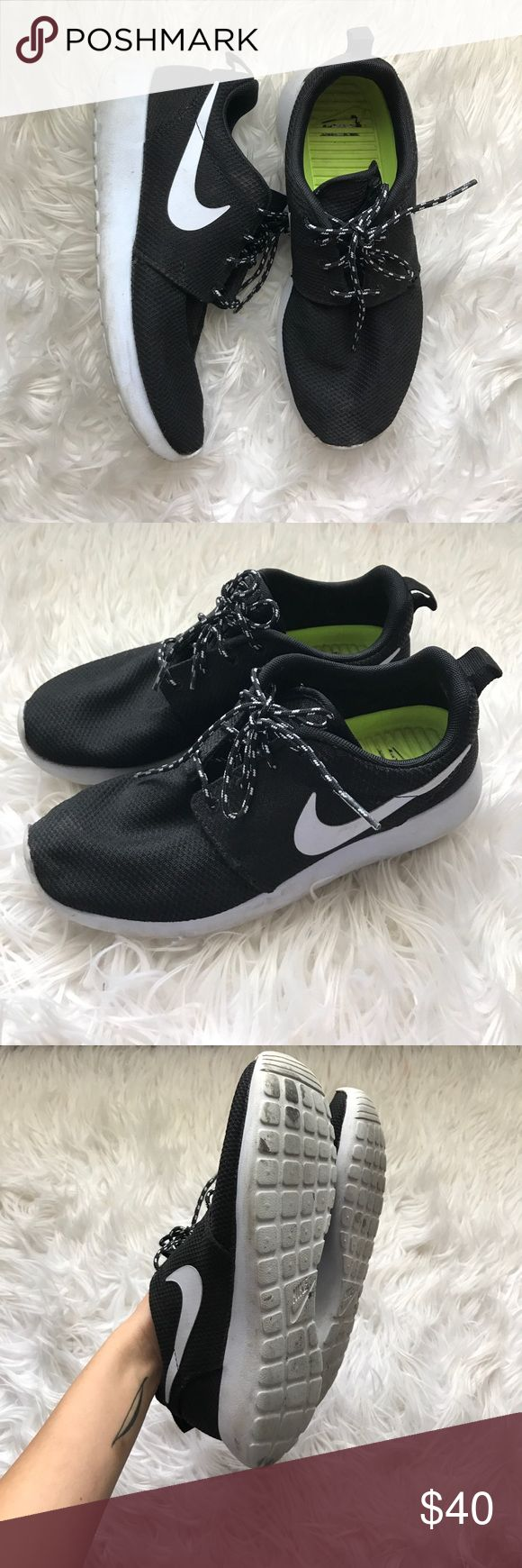 Classic Nike Roshe runs The classic black and white roshe runs. Wore quite a bit so it's a bit dirty on the soles but a good scrub will make it look nice and clean! Nike Shoes Athletic Shoes