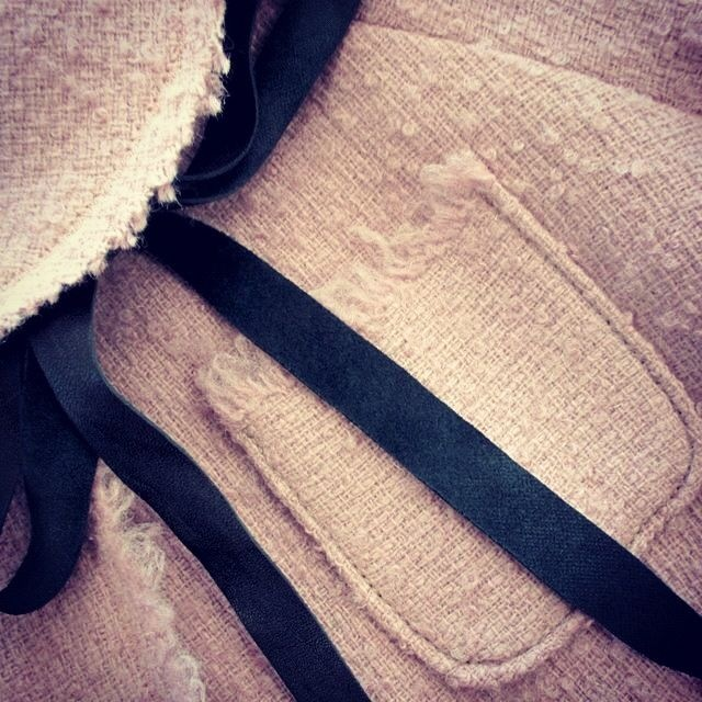 A detail of a coat by ...à_la_fois...