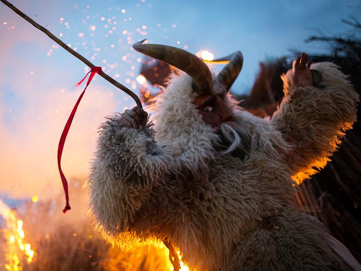 A traditional part of the Busó celebration in Mohács, Hungary, is the busós, a frightening character clad in a wooly coat. The end-of-winter carnival, which came to the southern Hungary town with Croats, also features the burning of a coffin that symbolizes winter. Photograph by Zsolt Repasy, National Geographic Your Shot, October 20, 2014