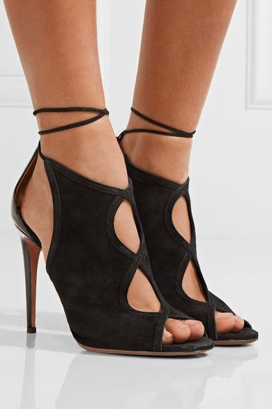 Aquazzura's 'Nomad' sandals are crafted from soft black suede that features the label's elegant teardrop-shaped cutouts. Trimmed with a leather heel, this pair has a peep toe and delicate ankle ties. Wear yours with one of the season's asymmetric skirts or dresses.