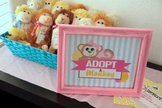 curious george inspired monkey party, adopt a monkey station