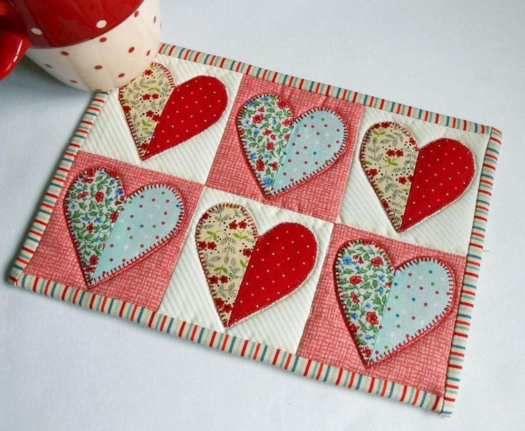 Half Hearted Mug Rug pattern. Scrappy fun for anybody who loves playing with fabric. Here it is in pretty, pretty red, white and blue.