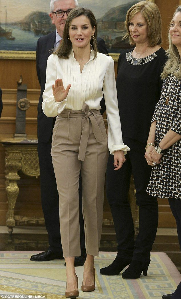 Queen Letizia of Spain looked immaculate as ever in high waisted trousers and a cream silk blouse as she welcomed representatives from UNICEF to Zarzuela Palace in Madrid.