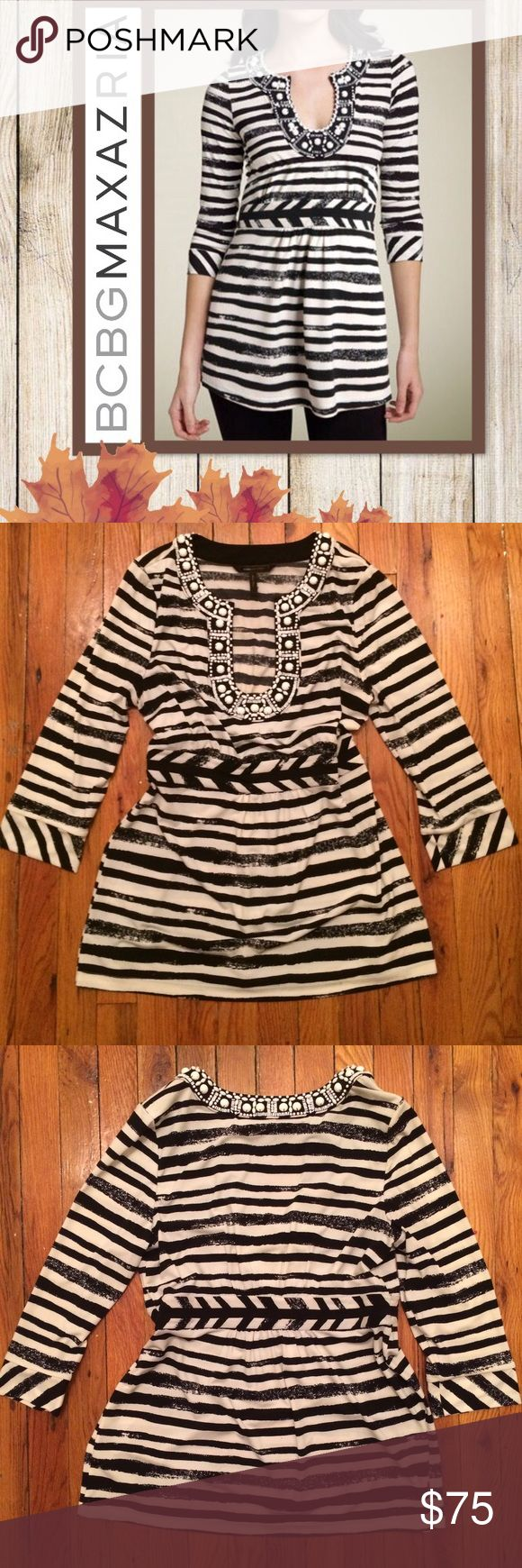 NWOT 🍂BCBGMAXAZRIA Top Tunic🍂 A beautifully beaded horseshoe neckline is the focal point of this chalk-striped tunic, gently shaped with a wide inset waist. 3/4 length sleeves. 🍂Polyester/spandex. Hand wash.  Brand new 🍁❤️💕 BCBGMaxAzria Tops Tunics