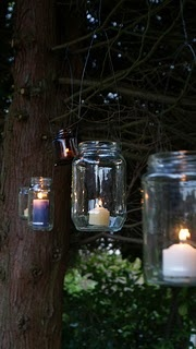Recycle jars into outdoor candle holders!