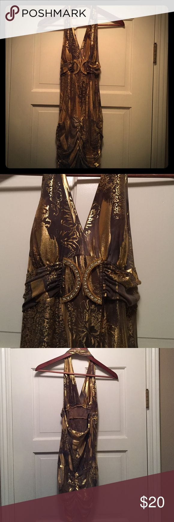 Tight-fitting gold night out dress This a dress that will turn heads. Very form fitting. Deep plunge, and low back. Only worn once for a photo shoot. Very very sexy Papaya Dresses Mini