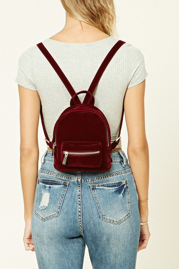 A pint-sized velvet backpack for just your barest essentials. | 39 Awesome Things To Buy At Forever 21 Right Now