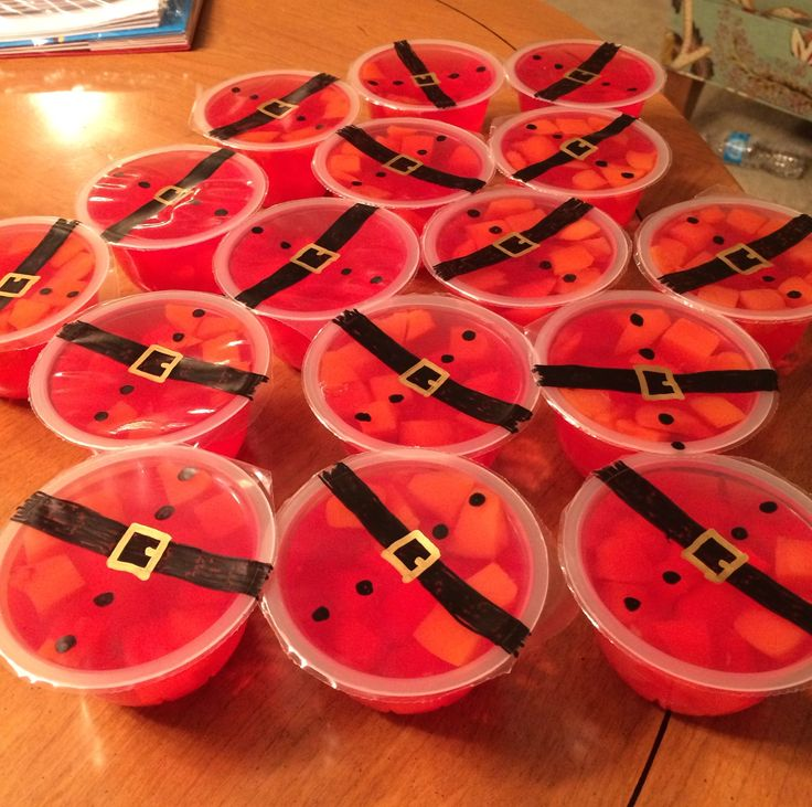 Preschool Christmas party! Gelatin fruit cups became Santa's belly like a bowl full of jelly with gold and black paint pens!