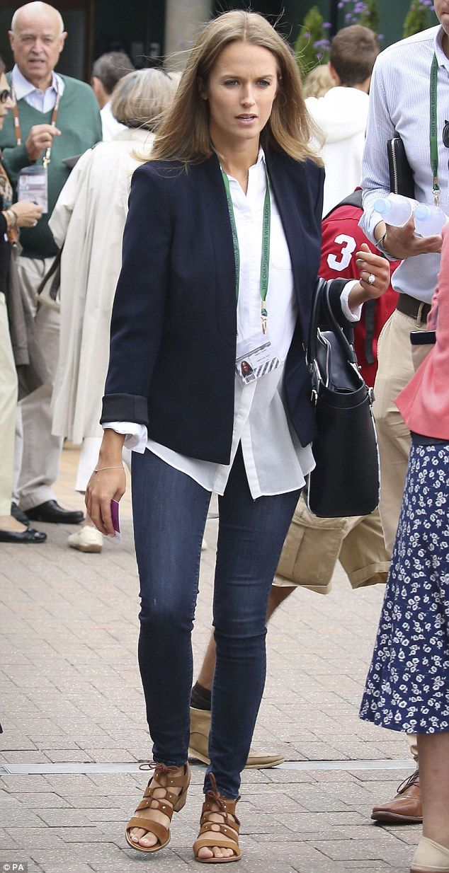 Kim Murray arrives at Wimbledon in jeans and a white shirt to watch husband Andy in his qu...