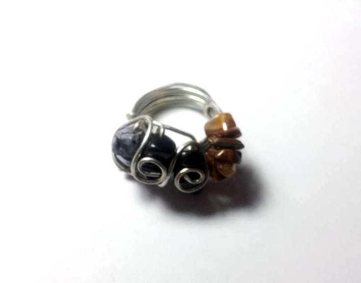 This ring is characterized by a large band in silver metal in which there are many little stones brown, silver and black. For info contact me, thanks! :)
