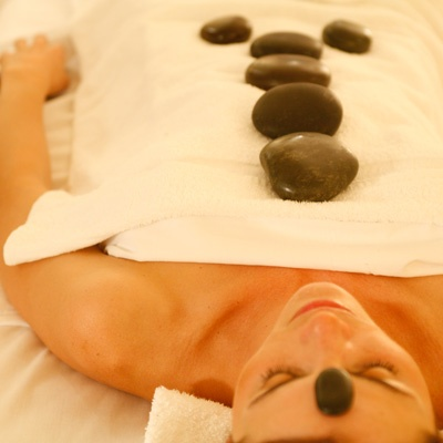 Hot Stone Therapy at CURE Salon & Spa