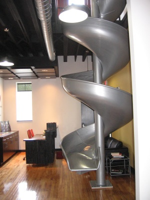 The lobby of the New Enterprise Opportunity Center in Lansing, Mich., complete with its unusual method of making it down to the first floor in a hurry. Business #incubator and #coworking space