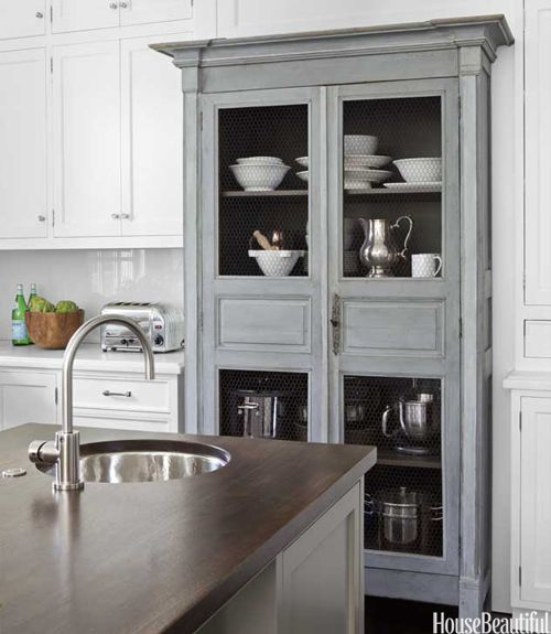 Chocolate brown island counter (made from walnut) gives warm wood feel to white kitchen, love the french gray cabinet
